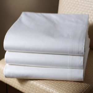 Folded White Flat bed sheet by a london brand